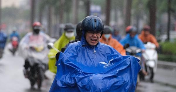 Không khí lạnh tràn về, người dân miền Bắc có thể đi làm khai xuân trong mưa rét