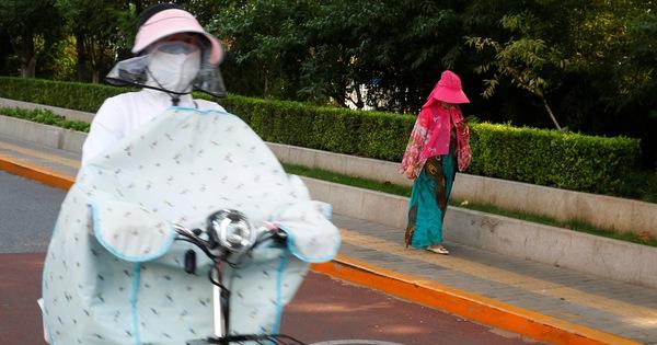 Sau mưa lũ tơi bời, Trung Quốc lại hứng nắng nóng đến 40 độ C